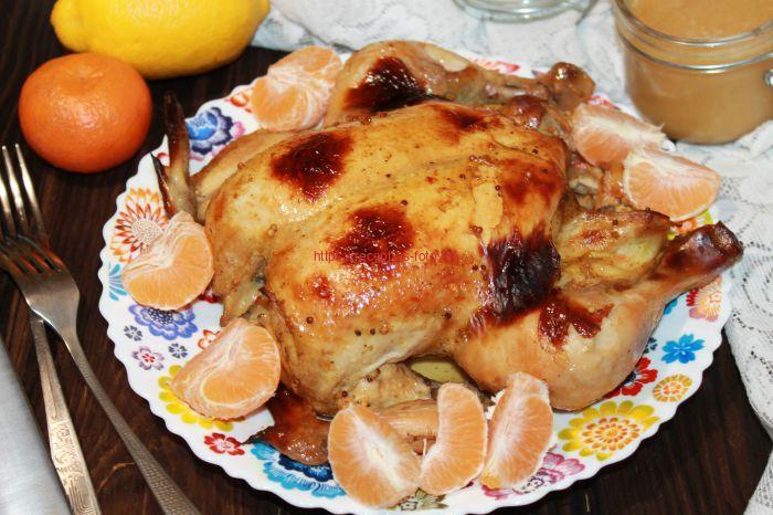 курица с апельсинами на блюде